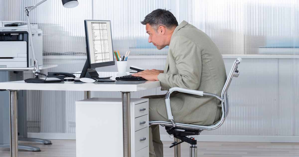 Man hunched over at desk